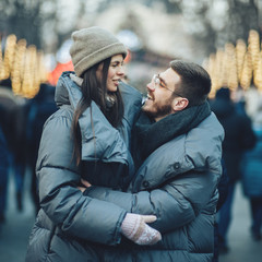 Christmas romantic sensual couple in love to cold winter day ove