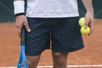 Detail of a tennis player during a game on a clay court