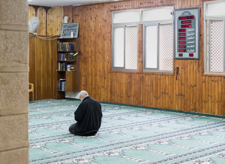A believing muslim prays in The White Mosque - Al-Abiad in the old city of Nazareth in Israel
