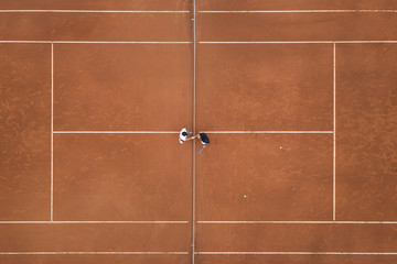 Aerial photo of a tennis match on clay court, handshake of the players