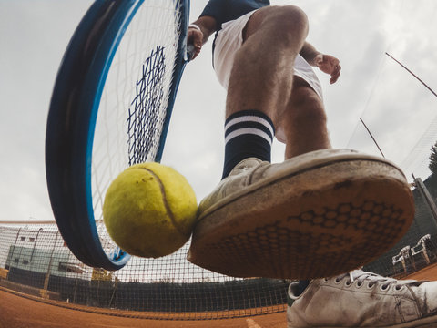 Detail of the grip of a ball during a tennis match on a clay court