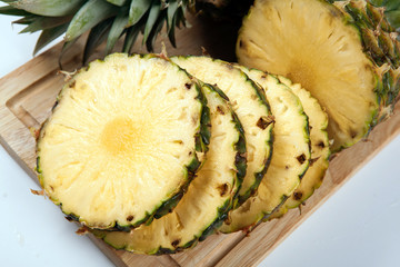 Slices of pineapples on a cutting board still life