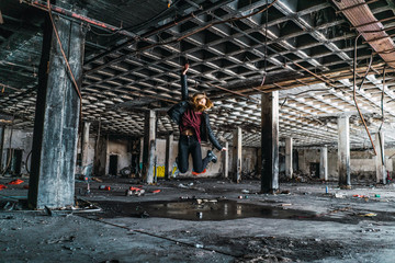 Woman jumping in abandoned room