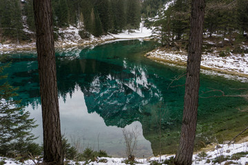 The Austrian Alps reflected in the amazing turquoise waters of the Gruener See
