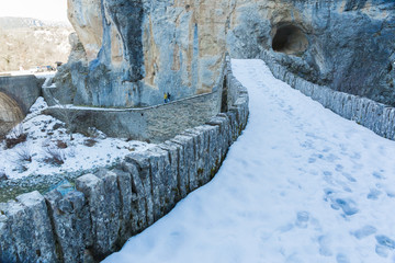 bridge old in Ioannina Zagori Greeece snow ice winter time