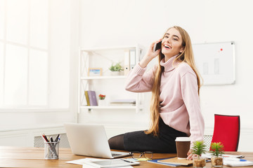 Business woman talking on phone at office
