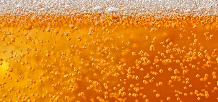 Macro shot of beer bubbles with foam
