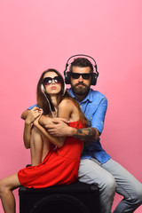 Guy with beard and lady hug and listen to music