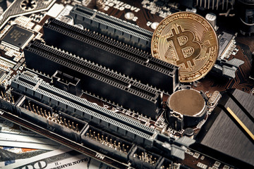 The coin of bitcoin lies on video card with dollars. Exchange bitcoin cash for a dollar