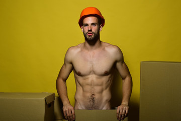 Macho with nice face wears helmet. Sexuality and moving concept.