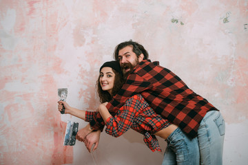 couple in love with spatula on pink background.