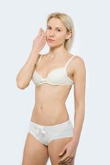 Beautiful slim tanned woman in underwear