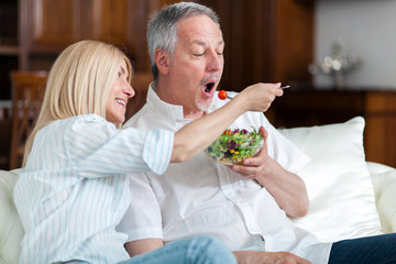 Healthy senior couple eating salad