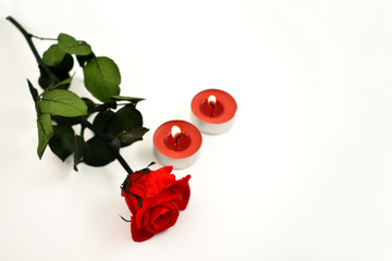 Romatic red rose with candle stock images. Red candle with red roses. Romantic roses on a white background