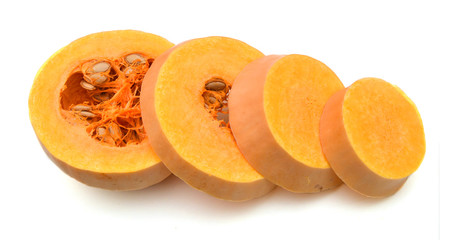 Cut up pieces of butternut Pumpkin, isolated on white. Slice of fresh fruit / vegetable.