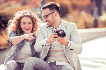 Young couple taking photo picture in the city.