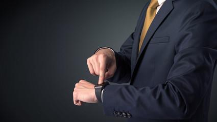 Man in suit wearing smartwatch.