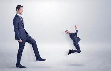 Small man fired by boss with white wallpaper