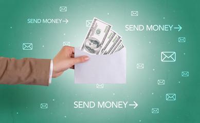 Hand holding envelope with symbols around