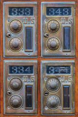 Four vintage american post office boxes