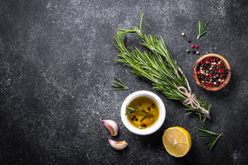 Selection of spices and herbs on dark background. Top view copy space.