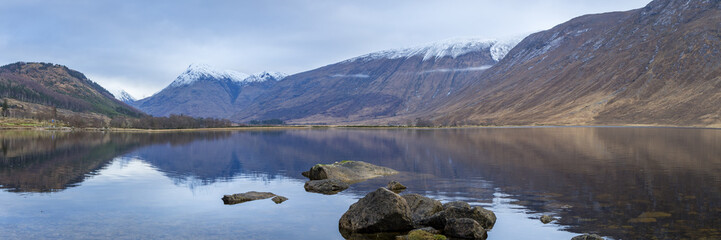 landscape view of scotland and loch etive with rocks in the foreground