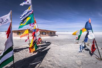 Papiers peints Amérique du Sud Uyuni Salt Flats - July 20, 2017: Flags landmark at the Uyuni Salt Flats, Bolivia