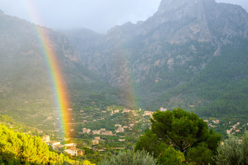 double rainbow in the mountains. Strong rainbow after rain. Fairyland.