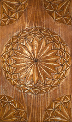 Veatical background: old carved wooden decorative panel handmade