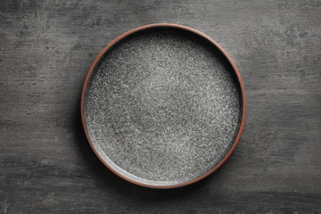 Ceramic plate on grey background