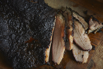 Close-up of smoked barbecue brisket on wooden surface