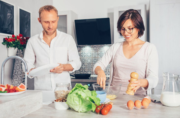 Family moments concept image - married prepare meal together.