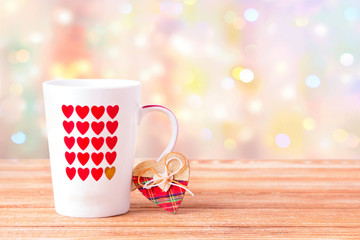 Mug with hearts on the table