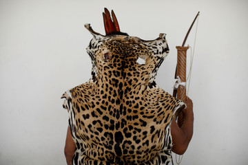 A Pemon indigenous and member of the National Constituent Assembly poses for a picture while wearing an animal skin in Caracas