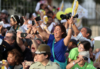 People cheer as Pope Francis drives past in Santiago