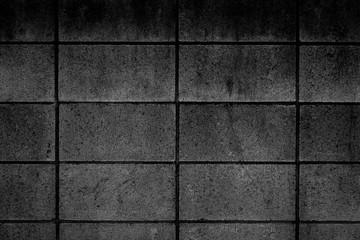 Black stone block wall seamless background and pattern texture