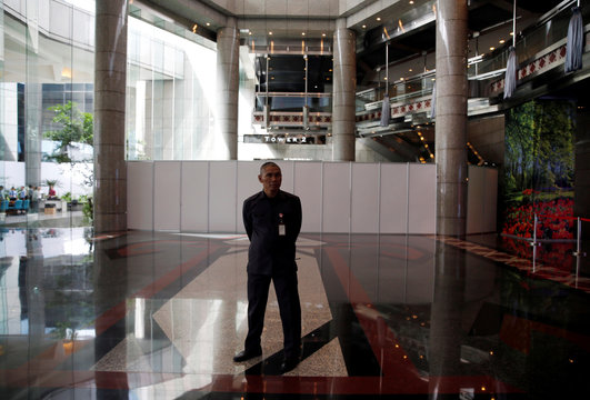 A security guard stands in front of the second floor of the Indonesia Stock Exchange building in Jakarta