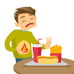 Caucasian white man standing near table with fast food and having stomach ache from heartburn. Man suffering from a heartburn after fast food. Vector cartoon illustration isolated on white background.