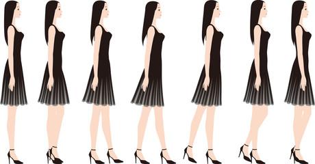 ハイヒールでゆっくりあるくドレスを着た女性