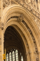 The architectural detail of the royal entrance below the Victoria Tower at the British Parliament building in London, England.