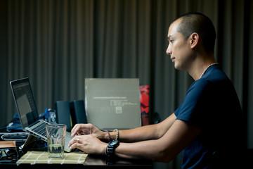 Lifestyle series: Asian man using laptop surfing internet