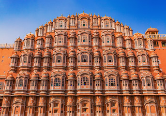 Jaipur Hawa Mahal palace made of red and pink sandstone. A primary tourist attraction in Rajasthan India.