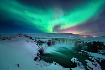 Godafoss waterfall with stunning aurora in the night sky of winter Iceland Fototapete