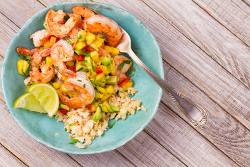 Shrimps with mango avocado salsa and cauliflower rice. View from above, top, horizontal