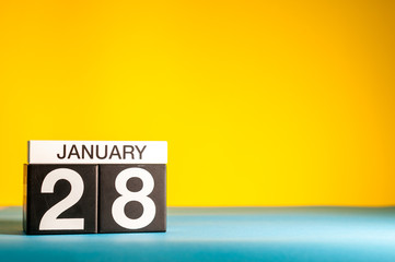 January 28th. Day 28 of january month, calendar on yellow background. Winter time. Empty space for text