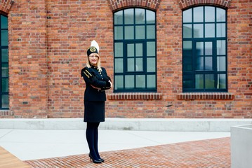 Woman black coal miner in gala uniform