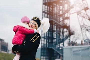 Working woman black coal miner with her child