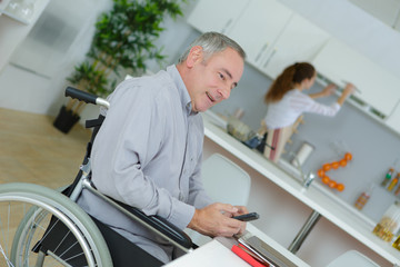 creative businessman in wheelchair on the phone at home