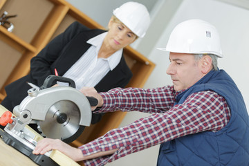 hiring manager observing the carpenter