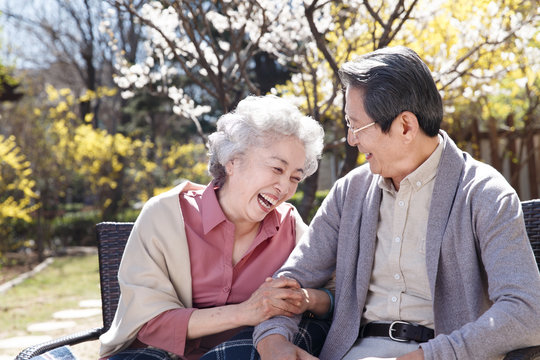 Happy senior couple relaxing outdoors
